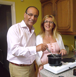 Photo of Tracy with Theo Paphitis in her kitchen making the creams